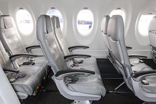 Seats for economy-class passengers on an AirBaltic Airbus A220-300