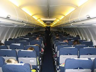 Salon of economy class on the Boeing-737-800 airline Nordstar