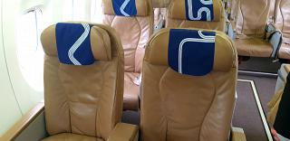 The business class cabin of the Bombardier Dash 8 Q400 of the Aurora airline