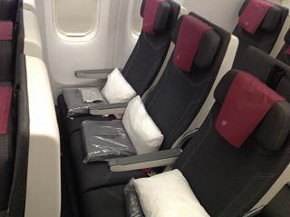 Passenger seats economy class aircraft Boeing 777-300ER Qatar Airways