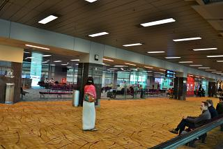 Drives in front of the departure gate in terminal 2 of Changi airport in Singapore