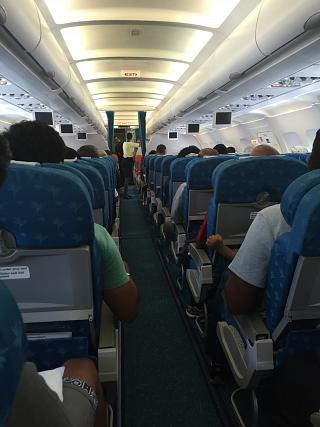 The passenger cabin of the Airbus A319 operated by Air Mauritius