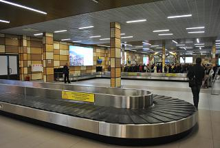 The arrivals and the Luggage belt at the airport in Simferopol