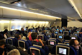 The passenger compartment of economy class in the Boeing 747-400 British Airways
