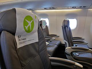 The passenger seats in the Embraer 170 S7 Airlines