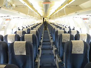 The passenger cabin of the aircraft Boeing-737-300 of airline NordStar