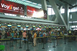Check in for departing flights at terminal 3 of Manila airport