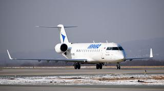 "Aircraft Bombardier CRJ-200ER airline ""iraero"" at the airport of Vladivostok"