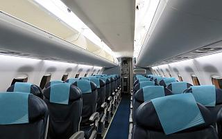 The passenger cabin of the Embraer 190 of the airline Buta Airways