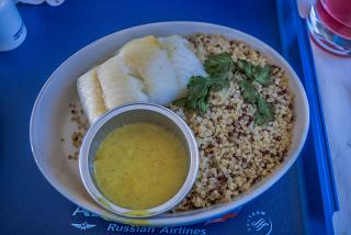 Halibut with quinoa with Curry sauce in the business-class Aeroflot