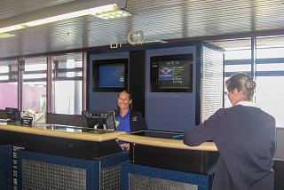 An employee of Southwest Airlines at the front Desk