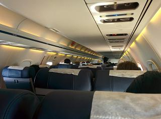 "The cabin of the Embraer ERJ-145 airline ""Komiaviatrans"""