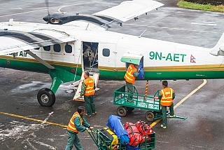 Loading baggage in aircraft DHC-6 Tara Air in Lukla airport