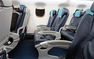 The passenger seats in the Embraer 190 of the airline Buta Airways
