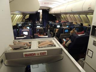 The passenger cabin on the upper deck of the aircraft Transaero B747-400 EI-XLF