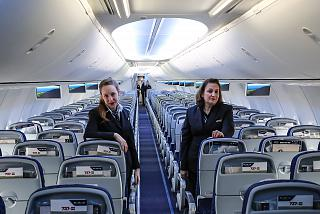 Stewardesses of the airline El Al in the cabin of the aircraft Boeing-737-900