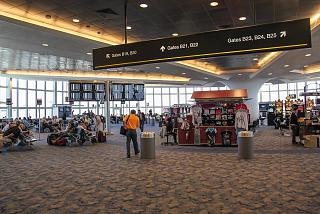 The waiting room with the gates in the concourse In terminal 1 of airport Las Vegas MC Karan