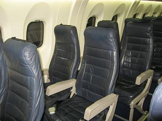 The passenger seats in the plane Bombardier Dash 8Q-400 airline airBaltic