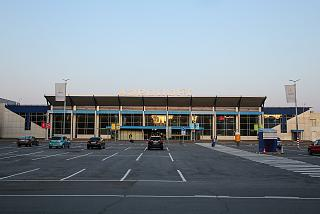 Car parking at the entrance to the passenger terminal of Tomsk airport