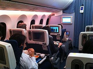 Salon of economy class in a Boeing 787 airline ANA