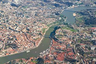View from the airplane porthole to the city center of Porto