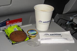 Cookies and coffee with cream on the flight Aegean Airlines