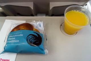 Pretzels with butter and juice - flight meals on SWISS flight Geneva-Barcelona