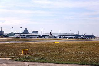 The view from the runway to the passenger terminals of the Prague airport