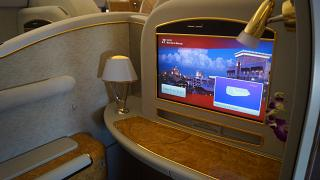 Individual monitor in the first class cabin in the Boeing 777-200 of Emirates airlines