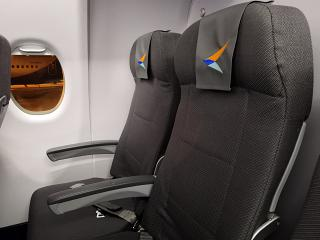 The passenger seats in the aircraft Sukhoi Superjet-100 of airline Azimut