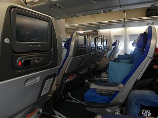 The economy class cabin of the Airbus A340-300 Cathay Pacific