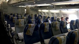 The economy class cabin in the Airbus A330-200 airline Gulf Air