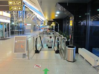 The escalator to the first floor in the terminal of the airport of Tallinn