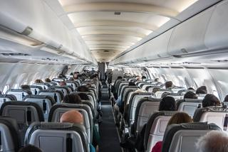 The passenger cabin of the Airbus A321 Alitalia