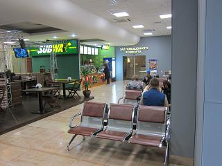 Cafe and the entrance to the Deluxe room on the 2nd floor secure area of the airport of Krasnodar
