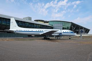 Ilyushin IL-18 DM-STA airplane on the background of terminal A of Leipzig-Halle airport