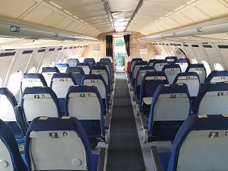 The passenger cabin of the aircraft Tu-154B-2 of Malev Hungarian Airlines