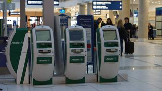 Self-service check-in for Alitalia flights at the airport of Bari