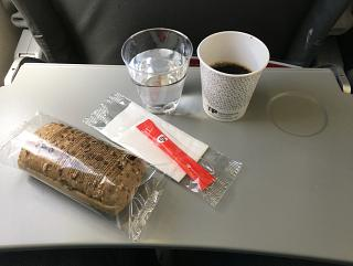 A chicken sandwich, water, coffee meal on a TAP Portugal flight Las Palmas - Lisbon