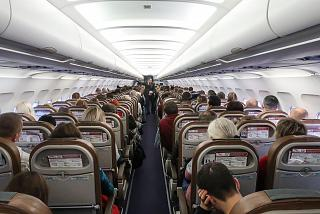 The passenger cabin of the Airbus A320 airline Red Wings