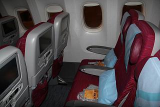 Salon of economy class in the Boeing-777-300 Qatar Airways