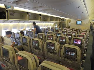 Salon of economy class in the Boeing-777-300 Emirates airlines