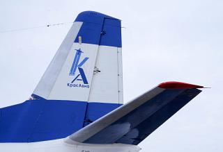 "The logo of the airline ""KrasAvia"" on the tail of the plane An-24"