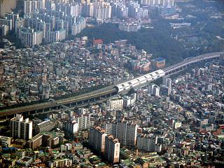 The residential areas on the outskirts of Seoul before landing at the airport Gimpo