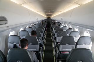 The passenger cabin of the Embraer 190 of TAP Express