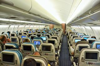 Salon of economy class of the Airbus A330-300 of Singapore airlines