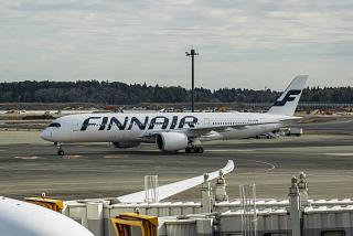 The Airbus A350-900 aircraft of the airline Finnair at the airport Tokyo Narita