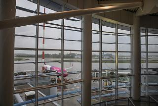 Windows with a view of the apron at the airport of Bucharest Henry Coanda