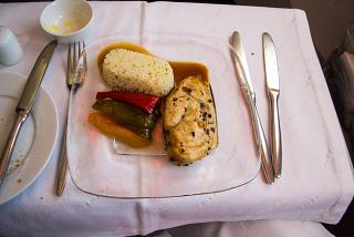 Second course - chicken breast with rice in business class of Aeroflot
