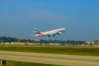 Boeing-777-300 Emirates take off from the airport of Milan Malpensa